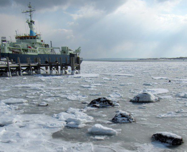 Sea ice packs Woods Hole harbor, surrounding the R/V Knorr in port at Woods  Hole Oceanographic Institution. Photo by Holly V. Moeller, 19 February 2015.