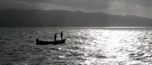 Silhouette of two fishers out in the morning in Samaná bay, Dominican Republic | Photo by Elizabeth Mclean