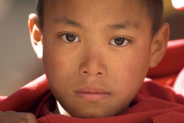 Young Bhutanese Monk, Photo © J. G. Morrison