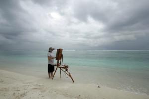Lisa Lebofsky painting along the coast of Hulhumale, Maldives.