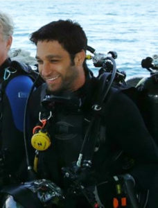 Photo of Alan Feldmesser getting ready for a day of Scuba Diving and underwater photography