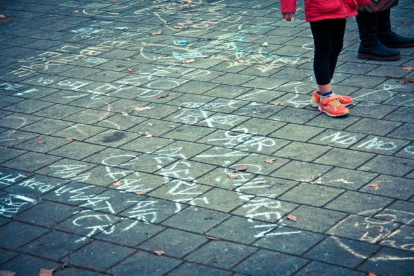 Thousands gather at Science World for the November 16th #DefendOurClimate day of action, Vancouver's contribution to more than 130 gatherings of Canadians across the country standing up for science-based action on climate change, and an end the fossil-fueled greed perpetrated by Harper and his embarrassing government. Children Chalk by Chris Yakimov | Flickr | CC BY-NC-ND 2.0