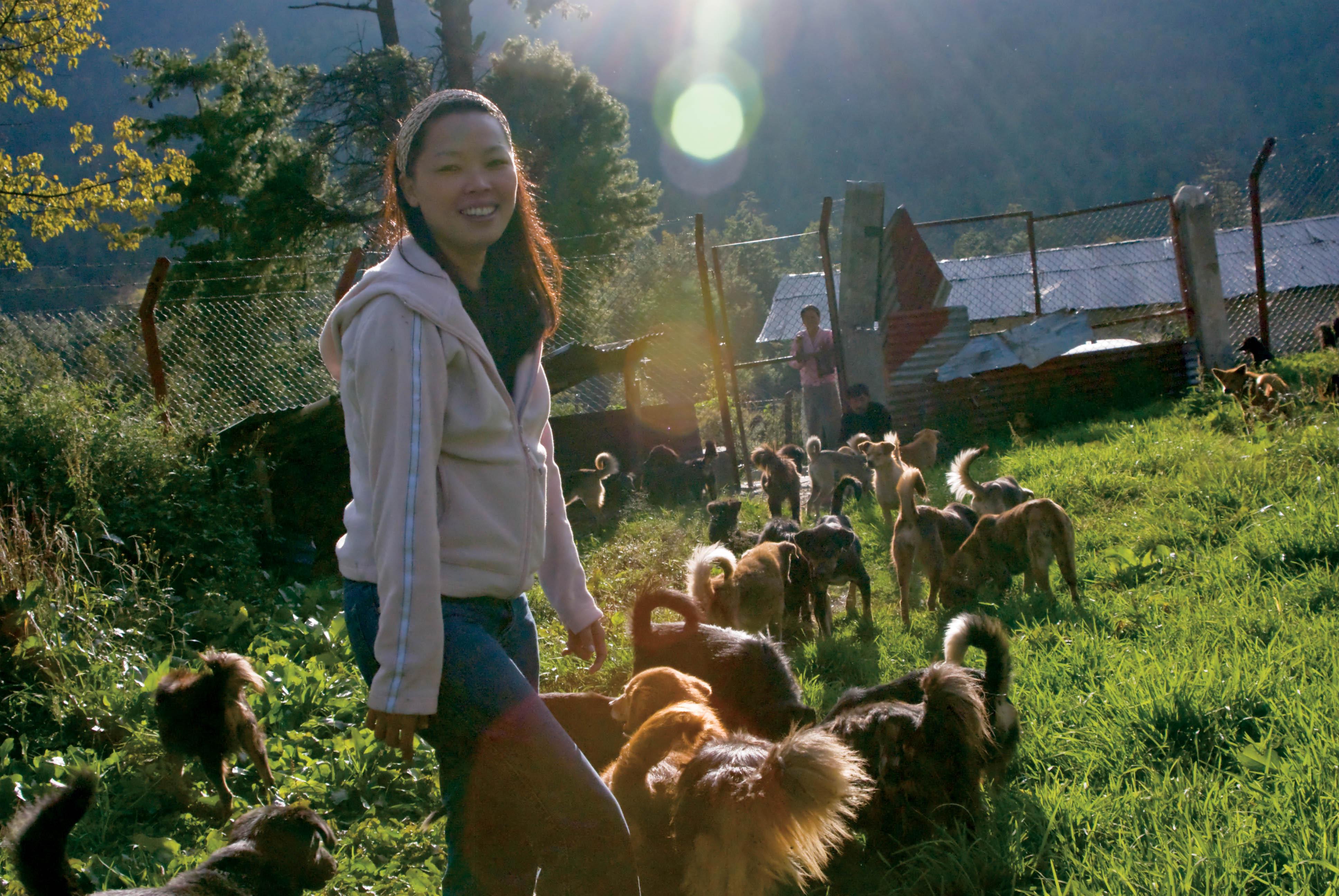 Ms. Tashi Payden at a Dog Sanctuary in Western Bhutan, © J.G. Morrison