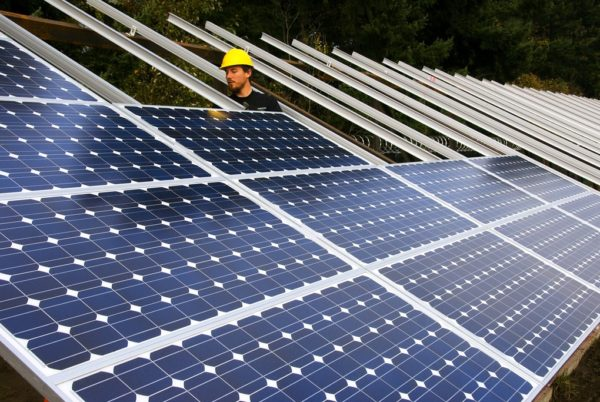 Installing solar panels by Oregon Department of Transportation | Flickr | CC BY 2.0