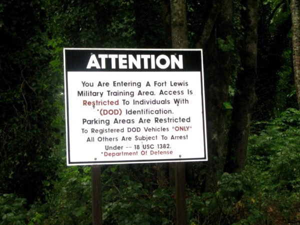 Fort Lewis warning sign, photo by Basia Irland