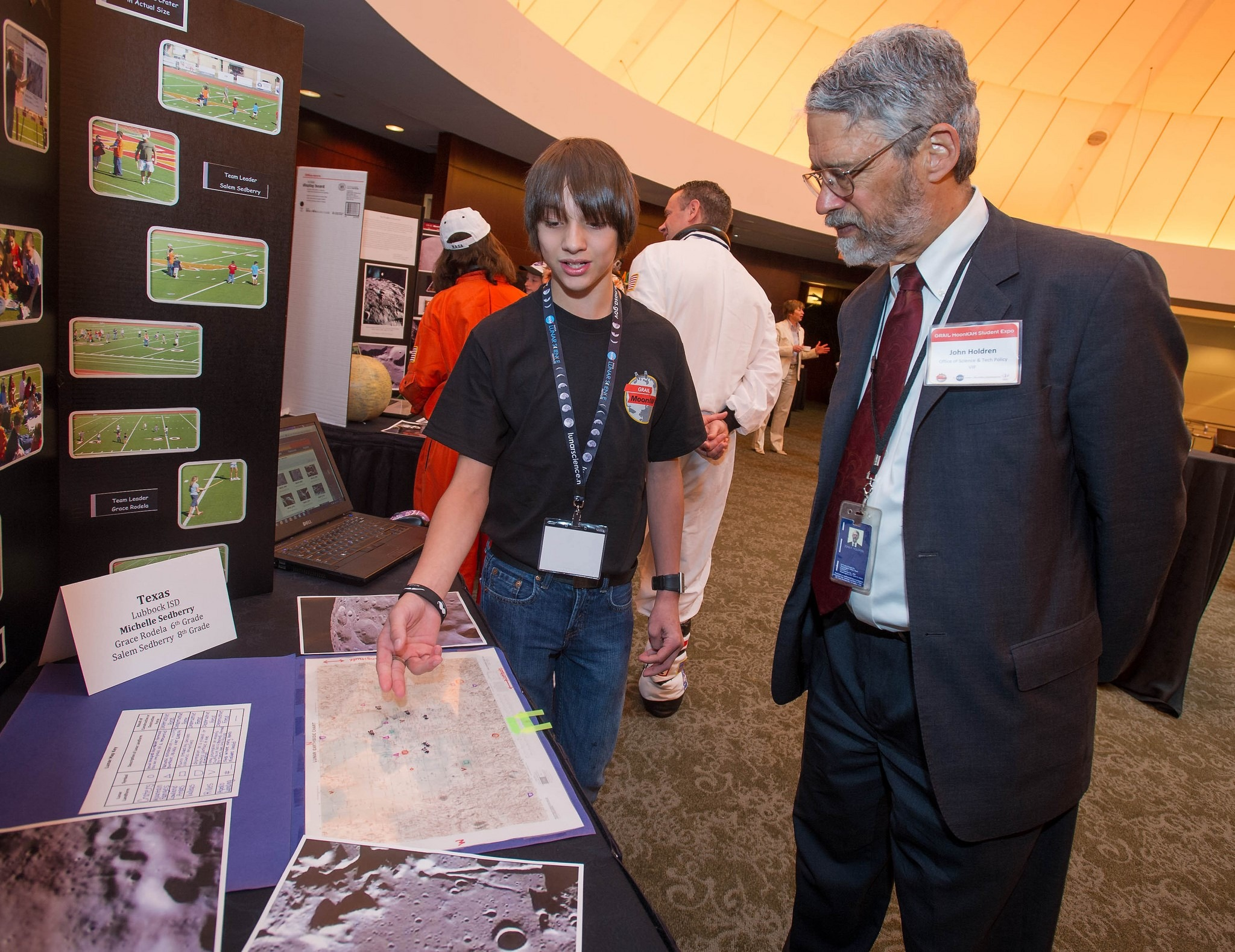 Dr. John Holdren listens as an unidentified student describes his project during the GRAIL MoonKAM student expo, Friday, June 1, 2012, in Washington. GRAIL MoonKAM (Moon Knowledge Acquired by Middle school students) is GRAIL's signature education and public outreach program. It is led by Dr. Sally Ride, America's first woman in space, and her team at Sally Ride Science in collaboration with undergraduate students at the University of California, San Diego. Photo Credit: (NASA/Paul E. Alers) | Flickr | CC BY-NC_ND 2.0