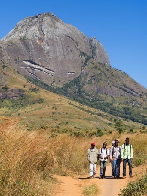 The Lupa Team walking between communities around the base of Mount Namuli.