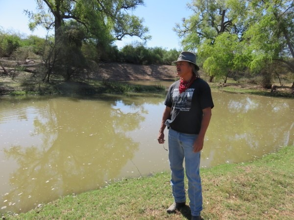 Manuel Esquer Nieblas standing next to the Río where he used to play as a child, but now is stagnant and polluted. By Basia Irland