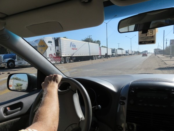 Yaqui Resistance Brigade stops trucks entering their land in protest about indigenous water rights. By Basia Irland