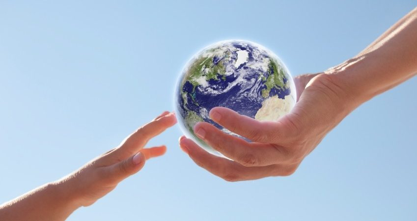 Handing over globe iStock_000015516936_Small (2)