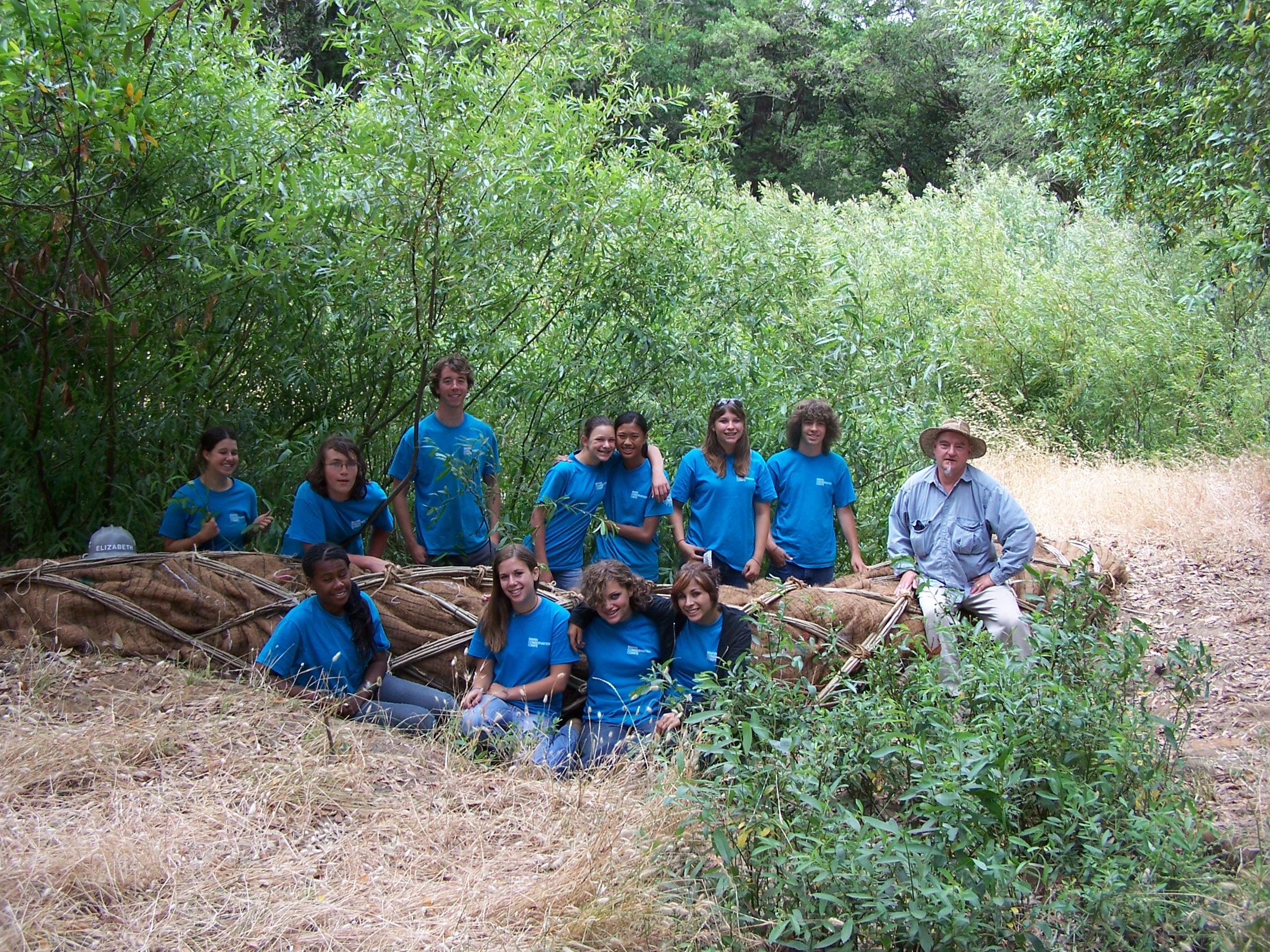 "Conservation Corps of the North Bay work with Daniel McCormick to complete ""Watershed as a Found Object"", 2008. Photographer: Mary A O'Brien"