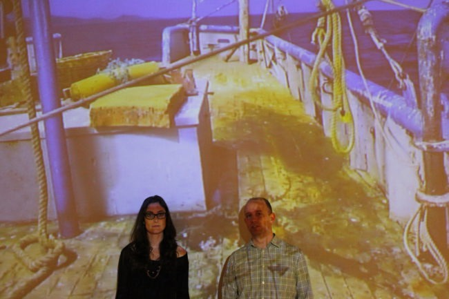 Johnson and Magrane in front of Bycatch video installation at University of Arizona Museum of Art, February 2017, courtesy of Maria Johnson and Eric Magrane; photo courtesy of Gina Compitello, University of Arizona Museum of Art