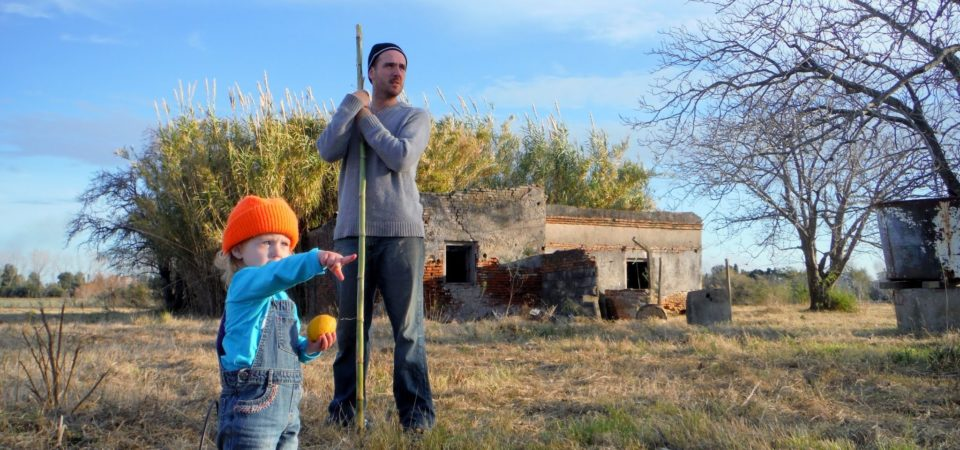 Co-director Patrick Fitzgerald and his daughter Isabel (then 2 years old) planting an orchard at Rizoma Field School.