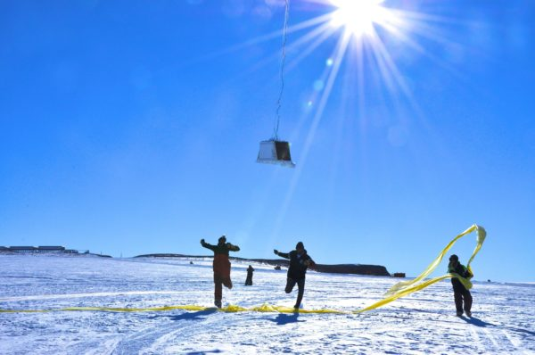BARREL team members run under the payload as the balloon first takes flight at the SANAE IV research station in Antarctica. | NASA | Flickr |  CC BY 2.0