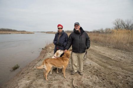 Dr. Jane Goodall and Thomas Mangelsen along the Platte River in Nebraska.