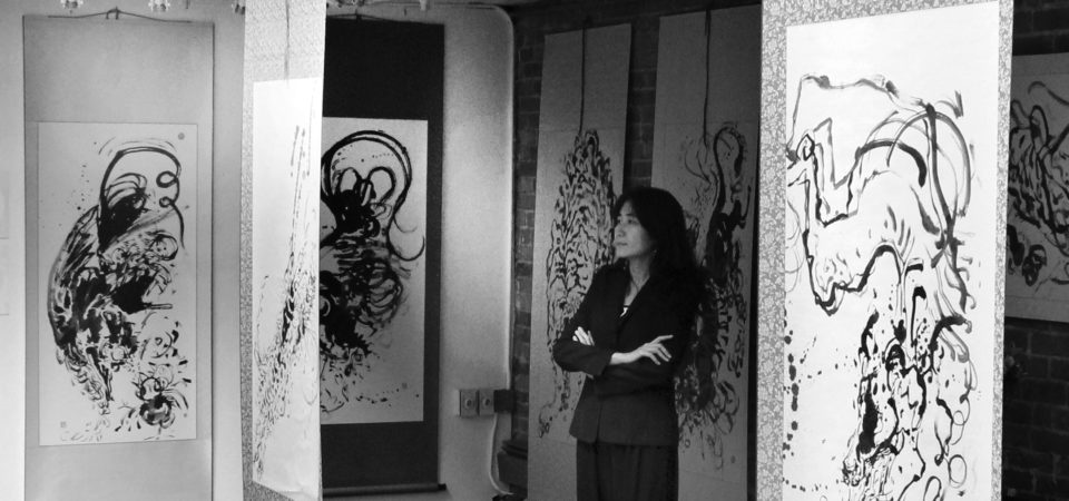 Anita Wong with her current work on exhibit at the Canessa Gallery