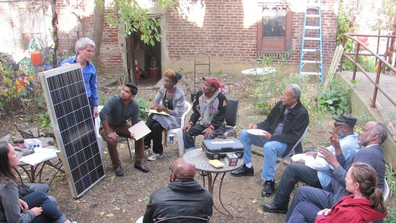 Swarthmore professor Carr Everbach leads a workshop with North Philadelphia community members about solar panels and solar energy at Serenity House, a community center in North Philadelphia, 2014. Image courtesy of Serenity Soular.