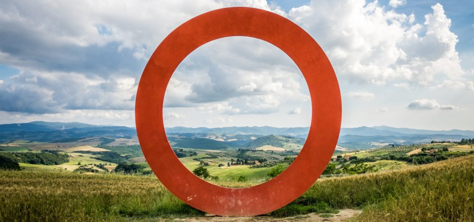 A red circle set against a Tuscan landscape by Giuseppe Milo