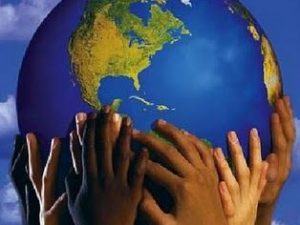 The earth cupped by diverse hands