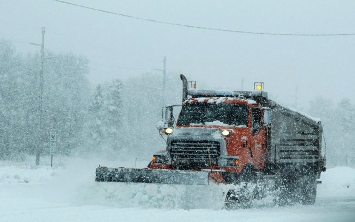 A heavy-equipment operator with the Fort McCoy snow removal contractor, Kaiyuh Services LLC of Anchorage, Alaska, drives a plow truck to move snow Jan. 9, 2017, at Fort McCoy. Kaiyuh became the Fort McCoy grounds and snow-removal contractor in September 2016. (U.S. Army Photo by Scott T. Sturkol, Public Affairs Office, Fort McCoy, Wis.)