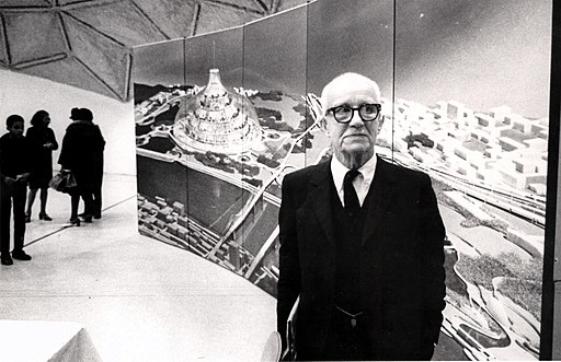 Buckminster Fuller with his domed city design | Wikimedia