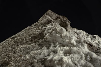 light shines on a dirty pile of snow