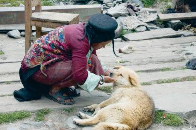 A Brokpa Woman and Her Dog, Eastern Bhutan, Photo (C) M.C.Tobias