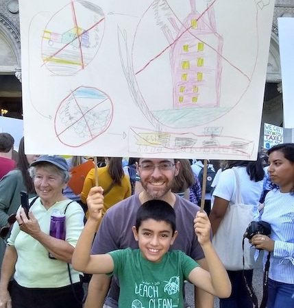 The author and his son at the Global Climate Strike in Hartford, Connecticut