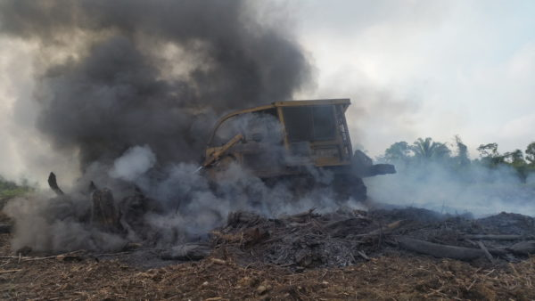 Destroyed landscape with caterpillar and smoke