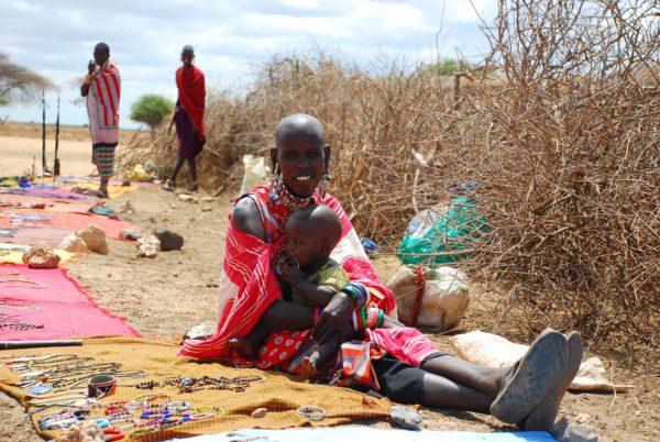 Kenyan woman and child, sitting on floor