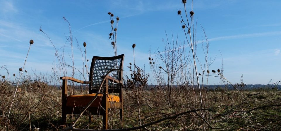 Fly-tipped chair, industrial wasteland, Widnes